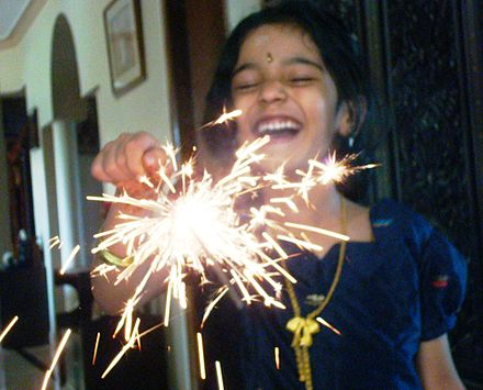 Diwali fireworks is a family event in many parts of India. People light up fireworks near their homes and in streets. Additionally, cities and communities have community fireworks. Above: Phuljhari, sparklers that are popular with some children on Diwali nights.[47] - Diwali