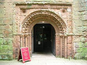 Romanesque Revival architecture in the United Kingdom - St. Nicholas, Kenilworth, west door 1570