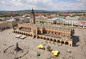 Main Square, Kraków - Main Square as seen from the tower of the St. Mary's Basilica, with Cloth Hall in its centre, free-standing Town Hall Tower behind it, and the Adam Mickiewicz Monument in the bottom-left