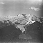 Sukoi Glacier, terminus of mountain glacier, icefall and bergschrund on the upper portion of the mountain, September 4, 1977 (GLACIERS 6905).jpg