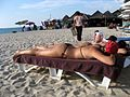 Sunbathe girl in Bang Tao Beach of Sheraton Grande Laguna Phuket - panoramio.jpg