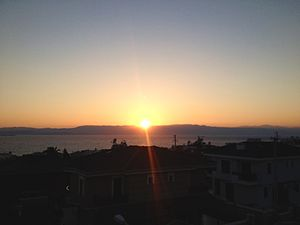 Chios Strait - Sunset over the mountains of Chios as viewed from Çeşme