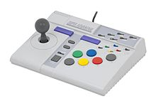 An arcade joystick with 6 buttons. It is called the Super Advantage.