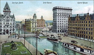 Clinton Square - Clinton Square next to the Erie Canal circa 1905: Syracuse Savings Bank on left, Gridley Building in center and Wieting Opera House on far right - The tall building (center on right) is the Onondaga County Savings Bank