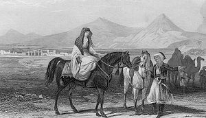 "Dragoman - Plate from The Crescent and the Cross by Elliot Warburton entitled ""Encampment at Baalbec, lady and dragoman in foreground."""
