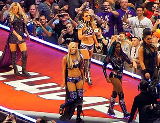 Naomi (wrestler) - Naomi (front center), along fellow Team B.A.D. & Blonde members, walking to the ring before their match at the WrestleMania 32 event in April 2016