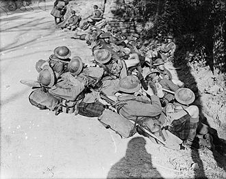 Highland Light Infantry - Troops of the Highland Light Infantry resting by the roadside on the way up to attack, 24 September 1917.