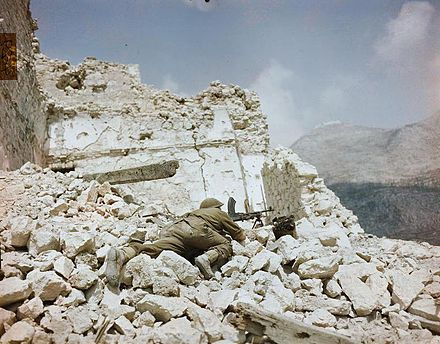 British soldier with a Bren gun in the ruins of Monte Cassino. The Campaign in Italy, May 1944 TR1800.jpg