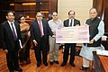 The Chief Executive Officer & Managing Director, IFCI Ltd., Shri Malay Mukherjee presenting a dividend cheque of Rs.92.30 crore to the Union Minister for Finance, Corporate Affairs and Defence, Shri Arun Jaitley.jpg