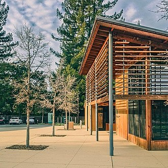 Portola Valley, California - Image: The Portola Valley Library Designed by Goring & Straja with Siegel & Strain wood sustainable leed design architecture landscape path tree library redwood evening glow (12243581666)