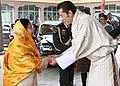 The President, Smt. Pratibha Devisingh Patil being welcomed by the 5th King of Bhutan, HM Jigme Khesar Namgyel Wangchuck on her arrival, at Paro International Airport, in Bhutan on November 05, 2008.jpg