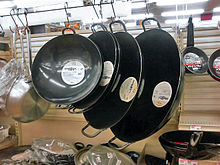 The woks of various sizes.JPG