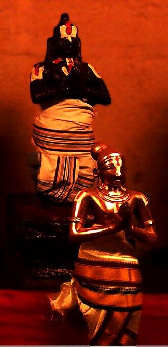 Thirumangai Alvar - Image of the granite and festival image of Thirumangai in Alwarthirunagari Temple