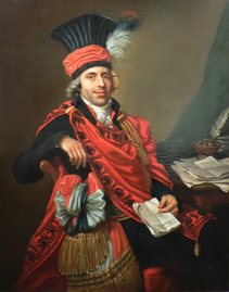 Portrait of a smiling man in ceremonial clothing