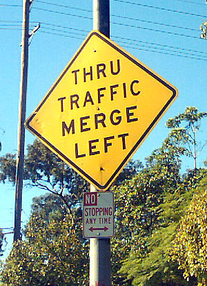 "English: ""Thru Traffic Merge Left"" w..."