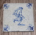 Tile with playing boy Holland.JPG