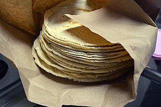 Unleavened flatbread made from ground corn (maize)