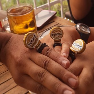 Tuborg Brewery - People wearing Tuborg caps as rings. Tuborg is one of the first beers in the market to launch the innovative ring pull cap.