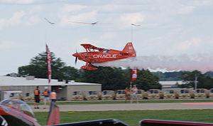 Sean D. Tucker - Tucker flying under ribbons at EAA AirVenture in Oshkosh, Wisconsin