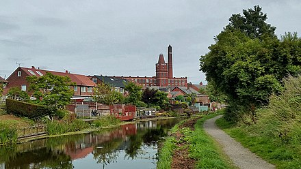 Tulketh Mill and its chimney, as seen from the Lancaster Canal Tulketh Mill and Chimney 20180806.jpg