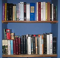 Two bookshelves full of books belonging to Unitedmissionary (2010)