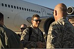 U.S. Air Force Chief Master Sgt. Alexander del Valle, right, the command chief master sergeant of the 366th Fighter Wing, welcomes Airmen returning home from a six-month deployment to Southwest Asia at Mountain 131003-F-WU507-152.jpg