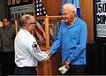 U.S. Air Force Senior Master Sgt. Thomas Kelly, front left, shakes hands and thanks Ewalt Shatz, a survivor of the attack on Pearl Harbor, during a Pearl Harbor memorial ceremony at the U.S. Pacific Command 131206-N-QN361-039.jpg