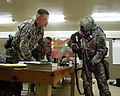 U.S. Army Spc. Jeremy Corley, right, with Bravo Company, 3rd Combat Aviation Brigade, 3rd Infantry Division (ID), Task Force (TF) Falcon, TF-Workhorse, shows Sgt. Maj. William Gammon, the plans noncommission 100916-A-BL368-045.jpg