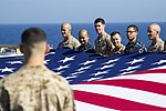 U.S. Marines and Sailors assigned to the 26th Marine Expeditionary Unit (MEU), and Sailors assigned to the USS Kearsarge (LHD 3), hold the American flag to commemorate the Fourth of July during their 2013 130704-M-BS001-006.jpg