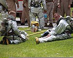 U.S. Marines assigned to Aircraft Rescue Fire Fighting stand by to decontaminate members of the Marine Corps Air Station Beaufort fire department at the sight chemical spill at the training pool at Marine Corps 130719-M-VR358-043.jpg