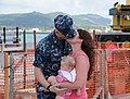 U.S. Navy Chief Machinist's Mate Alan Engle, left, assigned to the attack submarine USS Chicago (SSN 721), greets his family after the submarine returns to Apra Harbor, Guam, April 25, 2013, after completing its 130425-N-LS794-301.jpg