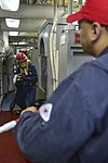 U.S. Sailors participate in a firefighting drill during general quarters training aboard the guided missile cruiser USS Monterey (CG 61) in the Arabian Sea June 8, 2013 130608-N-QL471-081.jpg