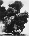 USS BUNKER HILL burning after a Japanese suicide attack. Near Okinawa, May 11, 1945. - NARA - 520657.tif