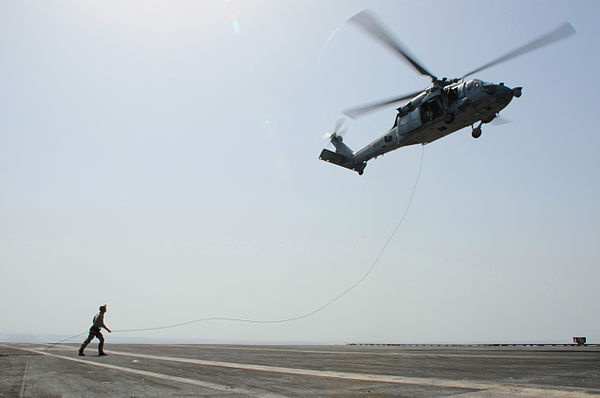 Fast-roping maneuvers from an MH-60S Seahawk, aboard USS George H.W. Bush