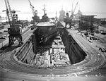 USS Okinawa (LPH-3) in a drydock at Philadelphia Naval Shipyard, in February 1963 (18497387).jpg
