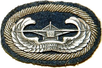 Glider Badge - U.S. Army Glider Badge with background trimming of unknown airborne unit from WWII