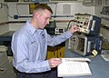 US Navy 020131-N-6247M-030 Sailor completes electronic bench test.jpg