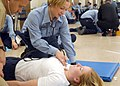 "US Navy 021101-N-2029P-001 Seaman Apprentice practices emergency medical technician skills during a practical exam given at the U.S. Navy's Hospital Corpsman ""A"" School.jpg"
