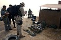 US Navy 030321-N-4655M-008 Rifles, a night-vision spotting scope and ammunition are among the cache of weapons and mines confiscated from an Iraqi barge.jpg