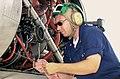 US Navy 030820-N-9779P-005 Aviation Machinist's Mate 2nd Class Josiah L. Burns, from St. George, Utah, inspects the fluids.jpg