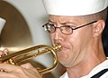 US Navy 031207-N-7391W-060 Musician 2nd Class Guy Gregg assigned to the Pacific Fleet Band plays a trumpet during the 62nd anniversary of the attack on Pearl Harbor, at the USS Arizona Memorial.jpg