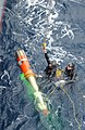 US Navy 040129-N-9288T-087 Search and rescue swimmers Quartermaster 2nd Class Justin Peel, from Polson, Mont., and Sonar Technician Surface 2nd Class Stephen Stavros, from Springtown, Mass., secure an MK-46 exercise torpedo.jpg