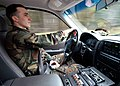 US Navy 040302-N-6901L-004 Master-at-Arms 2nd Class Benjamin Mills drives a military police cruiser during a routine security patrol around Naval Air Station Whidbey Island, Wash.jpg