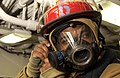 US Navy 040513-N-2101W-020 Fireman Craig Rozier adjusts his firefighting mask during a General Quarters (GQ) drill.jpg