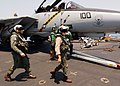 US Navy 040709-N-4374S-002 Pilots assigned to the Jolly Rogers of Fighter Squadron One Zero Three (VF-103) approach an F-14D Tomcat ready for a flight mission launched from USS John F. Kennedy (CV 67).jpg