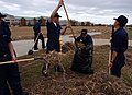 US Navy 040922-N-7559C-085 Students assigned to Naval Air Technical Training Center (NATTC), located on board Naval Air Station Pensacola, Fla., work as a team to clean-up debris.jpg