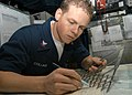 US Navy 040927-N-4565G-003 Aviation Warfare Systems Operator 2nd Class Jonathan Collins of Wildwood Florida, plots water space management for ships - edited.jpg