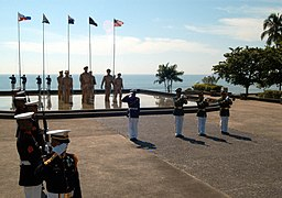 US Navy 041020-N-0493B-003 Backed by a monument marking the location of Gen. Douglas MacArthur's return to the Philippines 60 years ago, a Philippine Marine Corps honor guard stands at attention during the playing of Taps.jpg