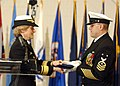 US Navy 041021-N-5576W-001 Rear Adm. Ann E. Rondeau accepts her command flag from Command Master Chief James Parlier, during a traditional change of command ceremony in the Midway Ceremonial Drill Hall at Recruit Training Comma.jpg