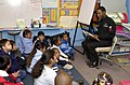 US Navy 050207-N-2143T-009 Operation's Specialist 2nd Class Perry LaCore, assigned to Commander Cruiser Destroyer Group Eleven (CCSG-11), reads to first graders attending Valencia Park Elementary School in San Diego, Calif.jpg